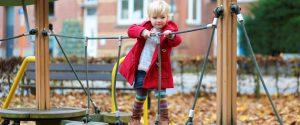 Happy toddler girl having fun at playground